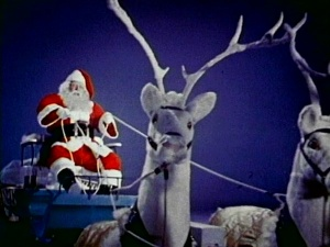 Santa with his mechanical toy reindeer